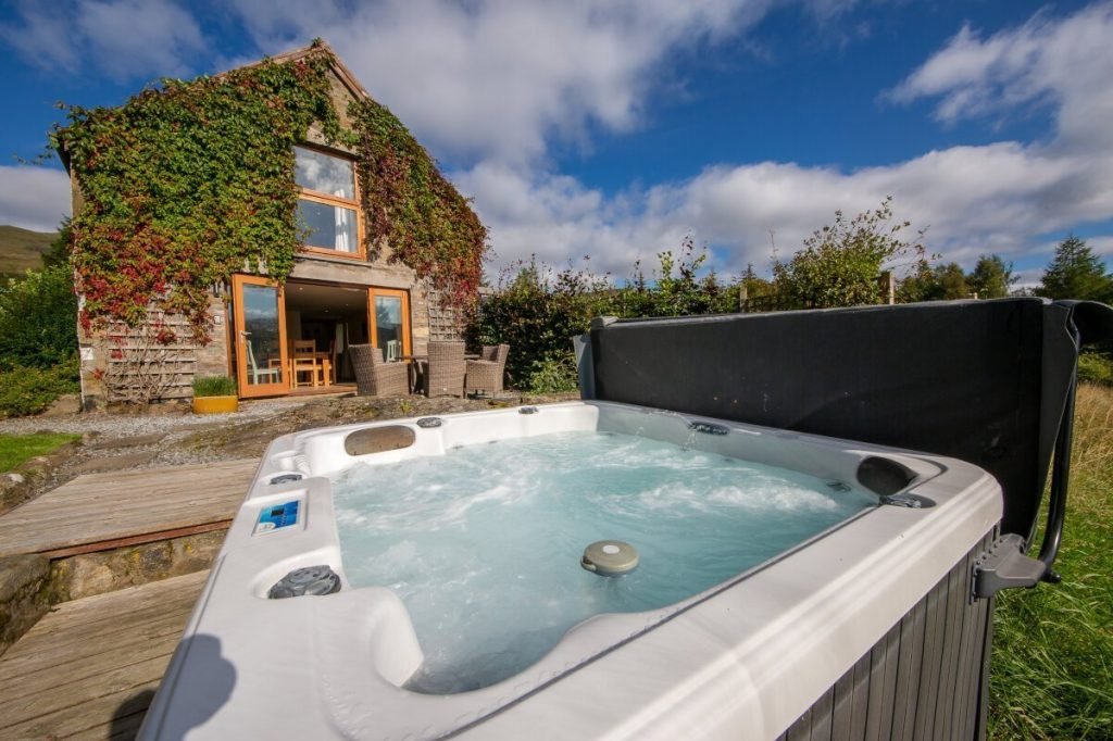 hot tub in garden looking at lodge on highland estate